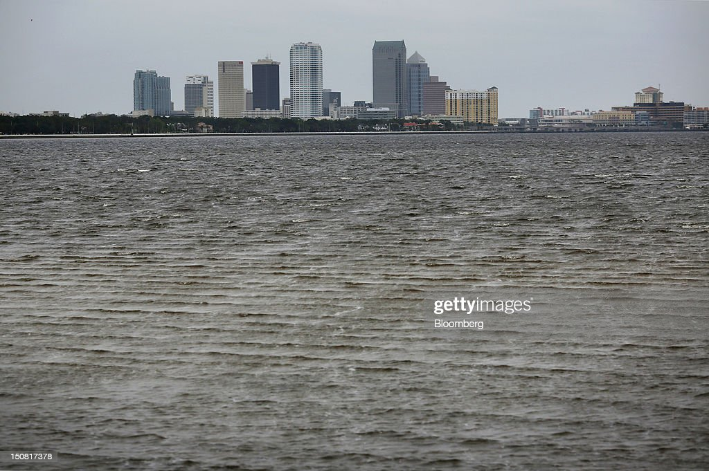 Overcast skies hang over the skyline of Tampa, Florida, U.S., on Sunday, Aug. 26, 2012. Tropical Storm Isaac regained strength as it entered the Gulf of Mexico, forcing oil and gas production sites in its path to close and threatening the coasts of four U.S. states with a possible Category-2 hurricane. Photographer: Victor J. Blue/Bloomberg via Getty Images
