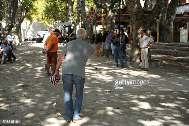 Overfifties playing 'tanque' bowls in the square 'place des Lices' in SaintTropez a spot for the city's bowls players