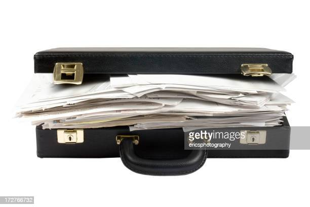Overfilled with documents briefcase