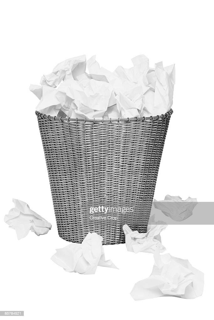 Overflowing alluminium wastepaper