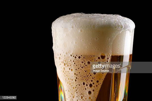Overflowing glass of beer