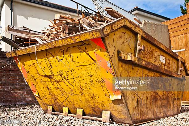 Overflowing industrial bin filled with wooden scraps
