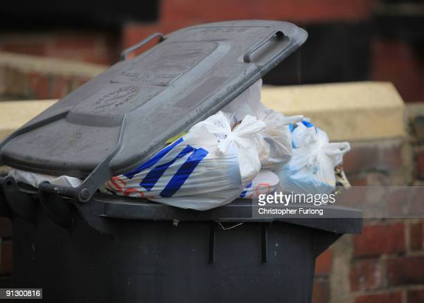 Overflowing refuse bins litter the streets in the Beeston area of Leeds on October 1 2009 in Leeds England A strike by bin men in Leeds is now...