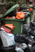 Overflowing refuse bins litter the streets in the Headingley area of Leeds on October 19 2009 in Leeds England A strike by bin men in Leeds is now...