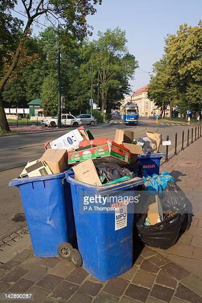 Overflowing wheelie rubbish bins, Krakow, Poland