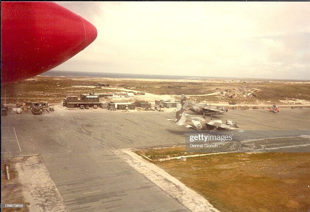 CONTENT] Overflying Stanley Airfield in a Brittan Norman Islander. November 1983 with two C130 Hercules Aircraft on the Airfield.