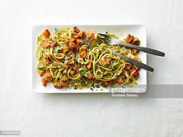 Overhead butternut squash pasta on white