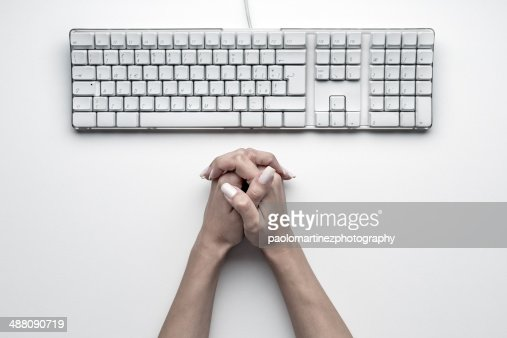 Overhead close up of pc keyboard and female hands