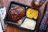 tv dinner on a tray with a remote