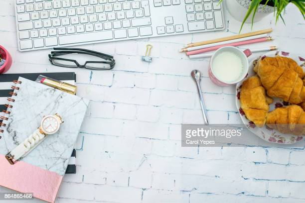 overhead laptop studio desk with morning breakfast