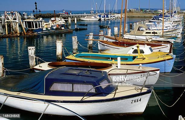 Overhead of boats moored at marina.