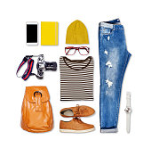 Overhead of hipster woman essentials. Outfit of casual woman on isolated background.