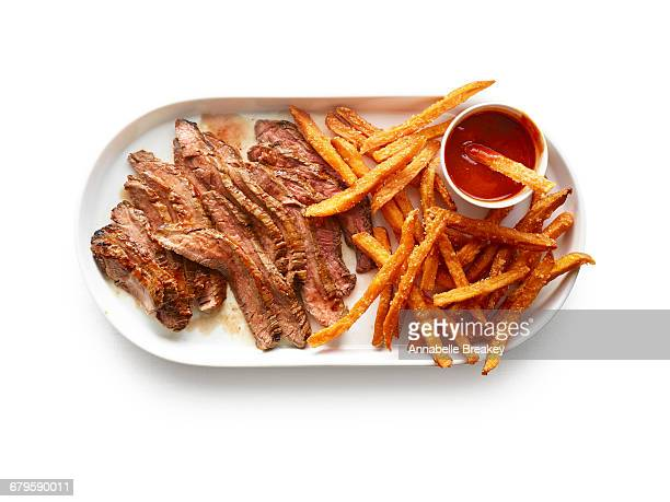 Overhead of grilled steak and sweet potato fries