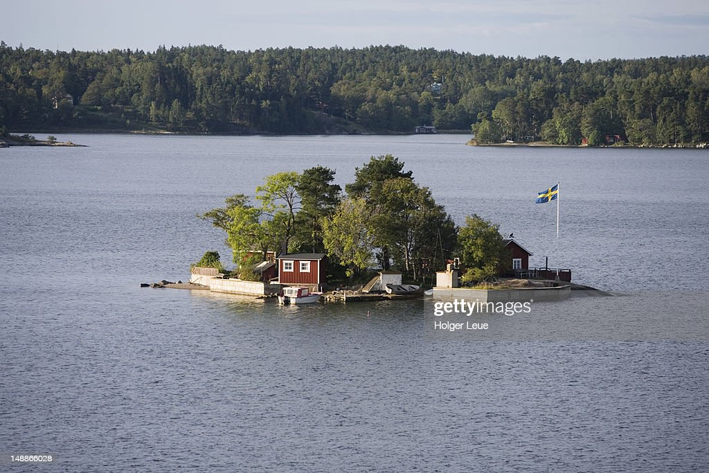 Overhead of houses on island in Stockholm Archipelago.