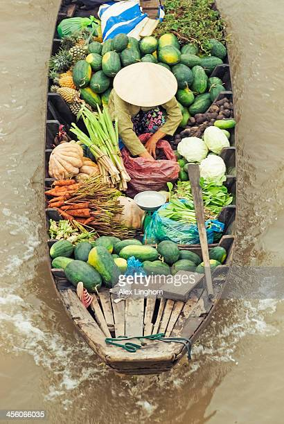 Overhead of long wooden boat selling food, Vietnam