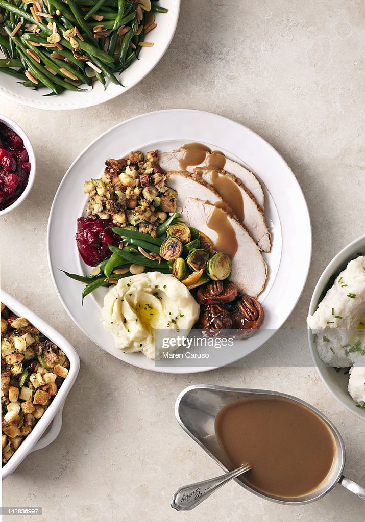 Overhead of turkey meal on white surface : Stock Photo