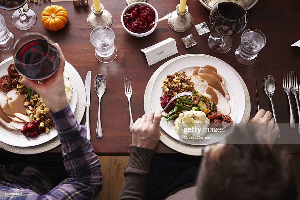 Overhead of two men eating holiday meal : Stock Photo