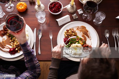 Overhead of two men eating holiday meal