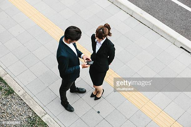 Overhead Portrait of Two Entrepreneurs Conversing on a Street