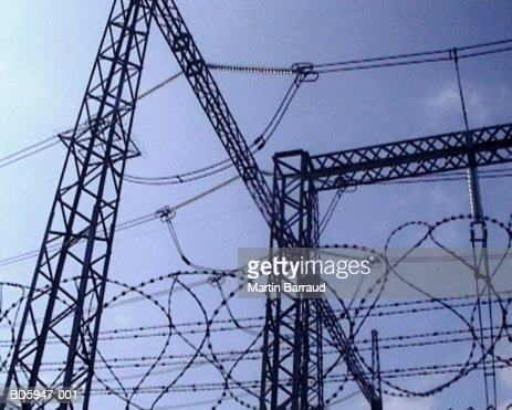 Overhead power cables and barbed wire, close-up (video still) : Stock Photo