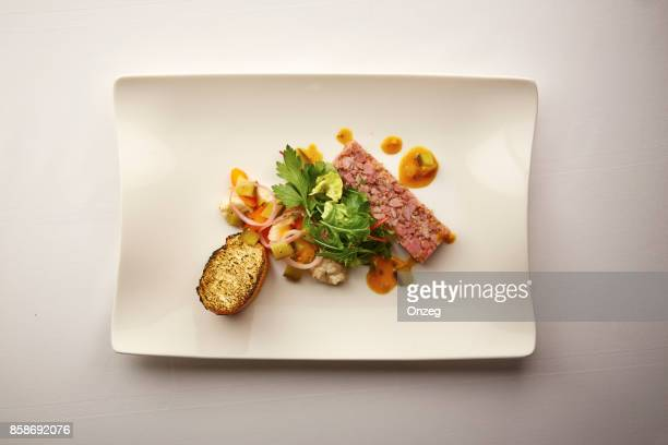Overhead shot of a gourmet plate of pate and bread