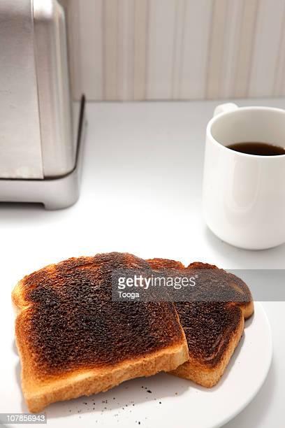 Overhead shot of burnt toast and black coffee