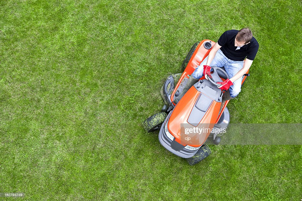 Overhead Shot of Gardener Mowing Lawn with Ride On Mower