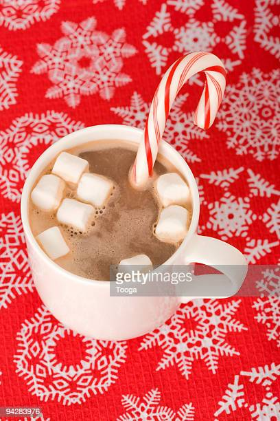 Overhead shot of hot chocolate with candy cane