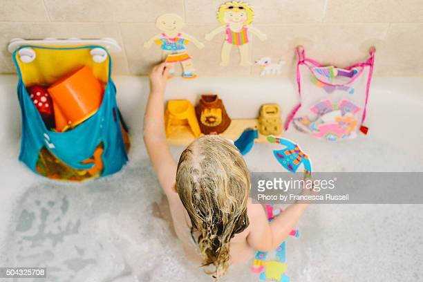 Overhead shot of little girl playing in bath