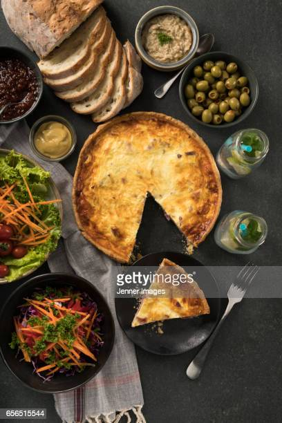 Overhead shot of meat quiche and salad for dinner.