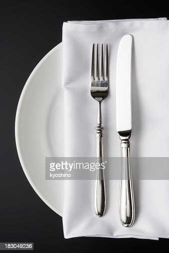 Overhead shot of place setting on the black background