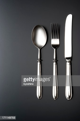 Overhead shot of silverware on black table with copy space