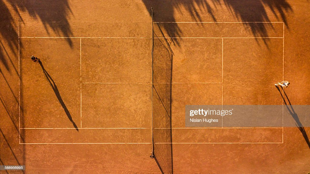 Overhead shot of tennis players on tennis court : Photo