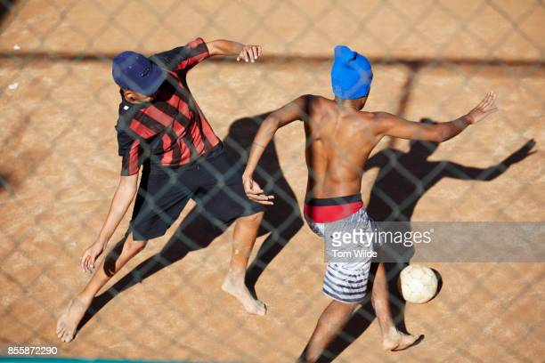 Overhead shot of two young men playing football
