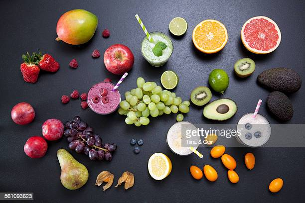 Overhead still life of fresh fruit and smoothies