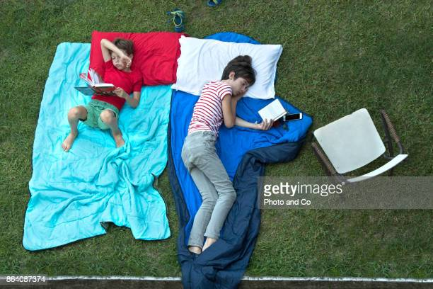 Overhead view boy and teenager read books