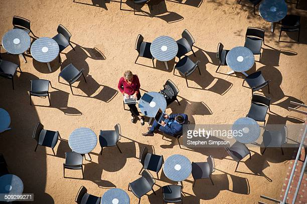 overhead view, cafe tables and business colleagues