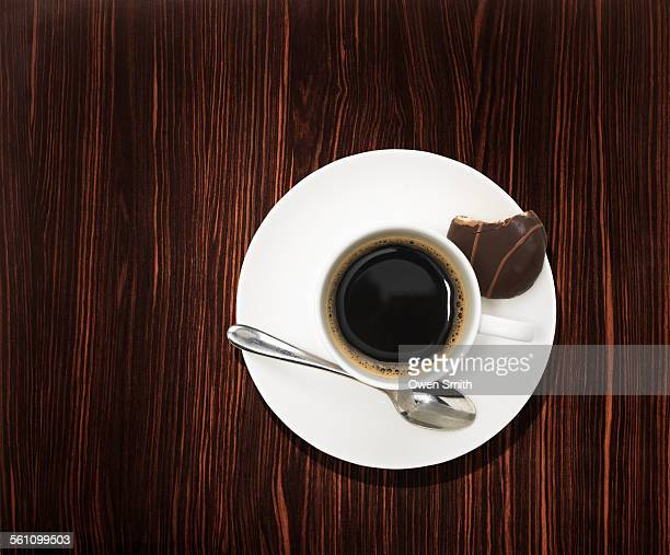 Overhead view of a black coffee on wooden table