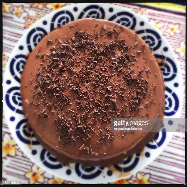 Overhead view of a chocolate cake on a plate