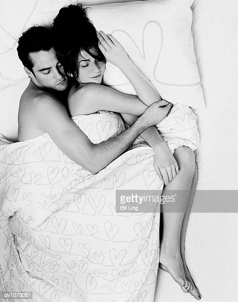 Overhead View of a Couple Sleeping Next to Each Other in Bed