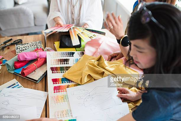 Overhead view of a team of fashion designers working
