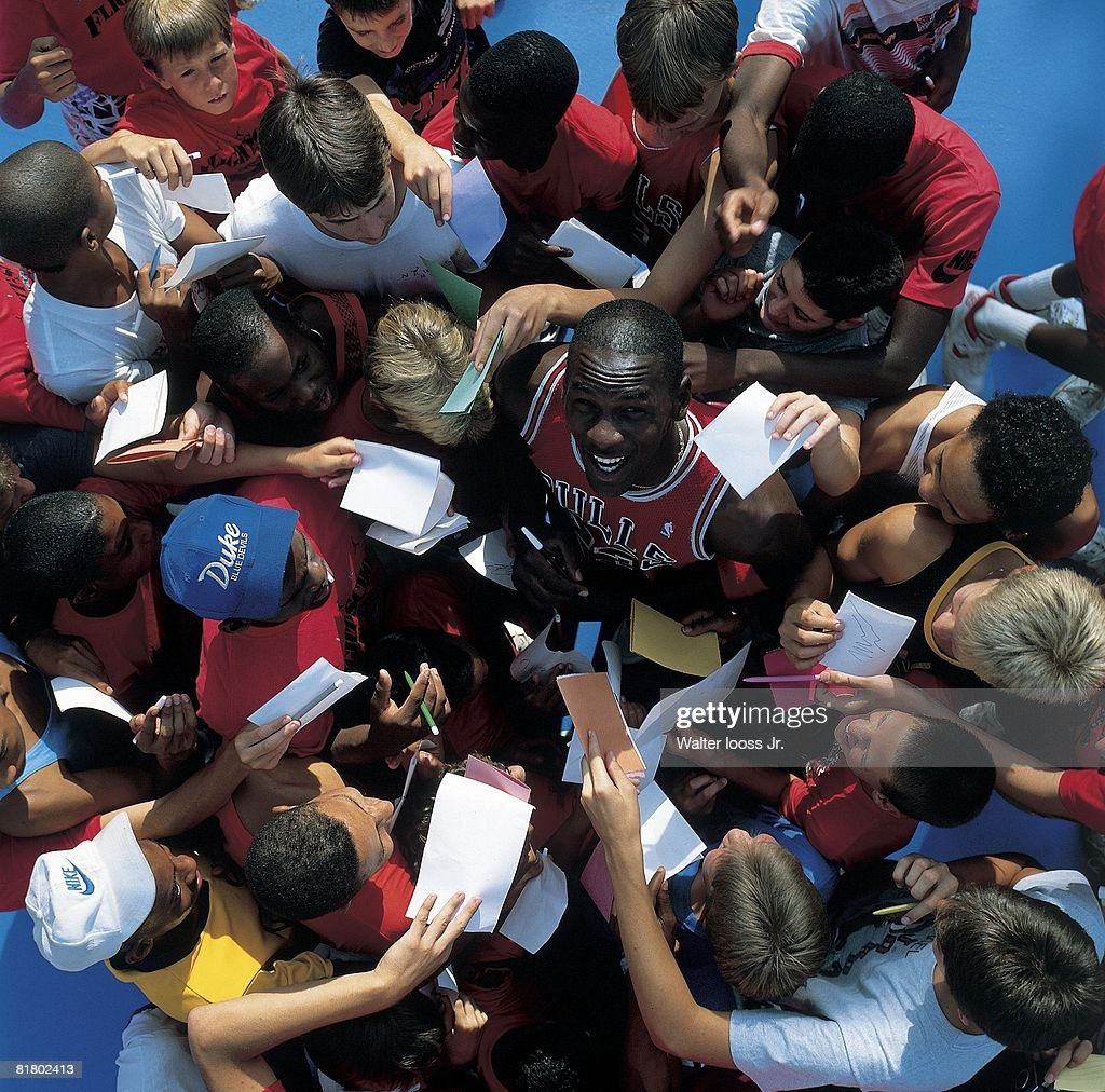 Aerial view of Chicago Bulls <a gi-track='captionPersonalityLinkClicked' href=/galleries/search?phrase=Michael+Jordan+-+Basketball+Player&family=editorial&specificpeople=73625 ng-click='$event.stopPropagation()'>Michael Jordan</a> signing autographs with fans after game vs Detroit Pistons, Detroit, MI 3/5/1987