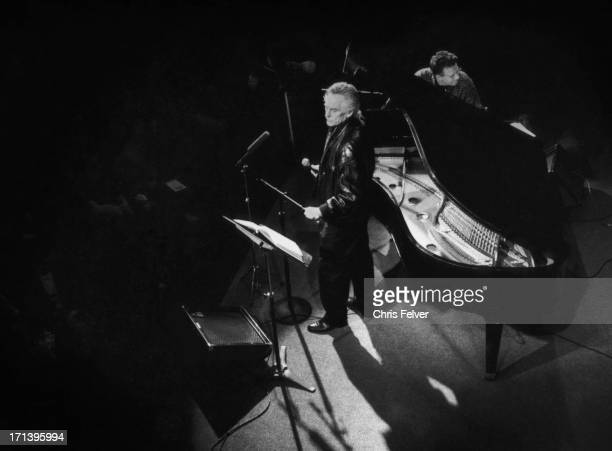 Overhead view of American Beat poet Michael McClure as he performs onstage with musical backing from keyboard player Ray Manzarek San Francisco...