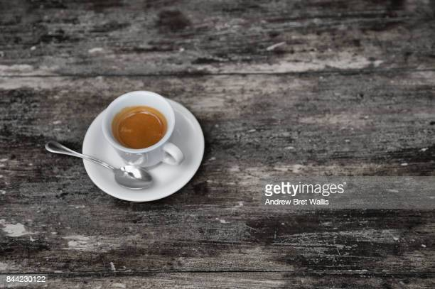 Overhead view of an espresso Coffee on a rustic table