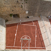 Overhead view of basketball court in walled city