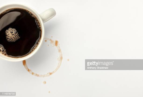 Overhead view of black coffee and coffee stain