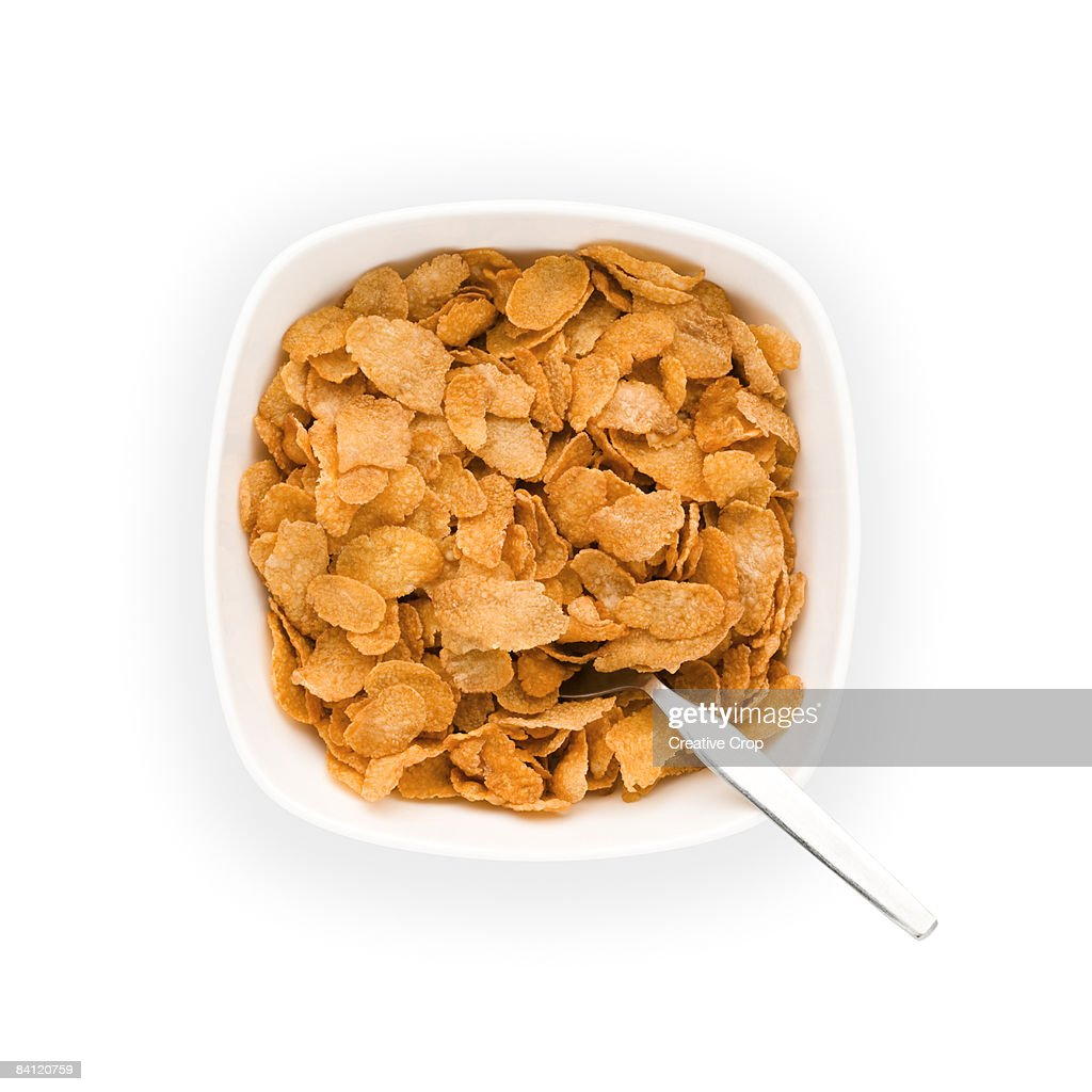 Overhead view of Bowl of Corn flakes with spoon : Foto de stock