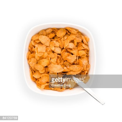 Overhead view of Bowl of Corn flakes with spoon : Stockfoto