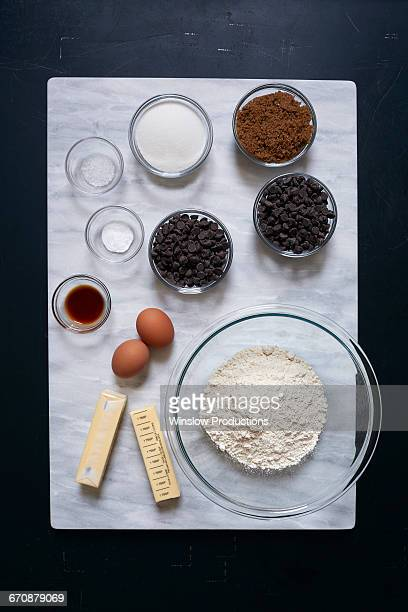 Overhead view of bowl of ingredients on marble board