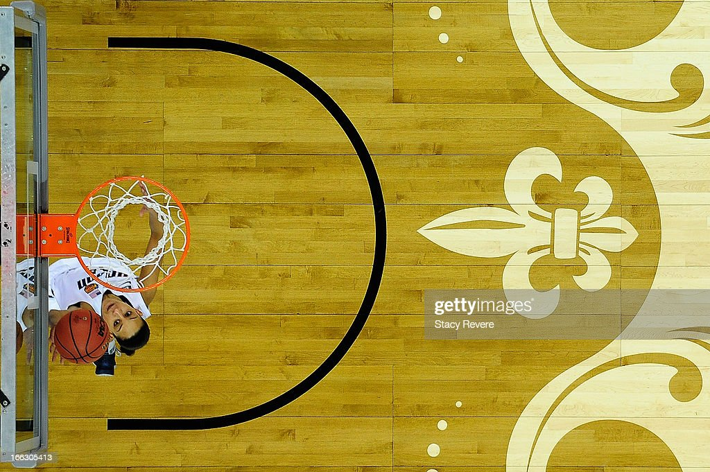 Overhead view of Bria Hartely #14 of the Connecticut Huskies as she shoots the ball against the Louisville Cardinals during the National Final game of the 2013 NCAA Division I Women's Basketball Championship at New Orleans Arena on April 9, 2013 in New Orleans, Louisiana.
